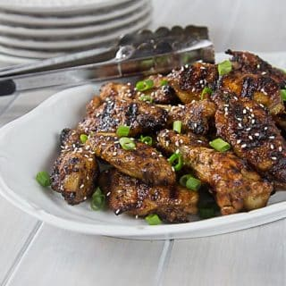 Spicy and saucy baked then grilled Thai style chicken wings will bring a tear to your eye! Hot, sweet, salty & tangy! | ethnicspoon.com
