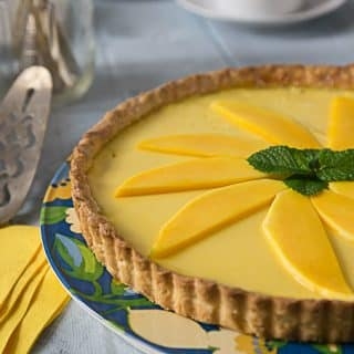 You will love the Tropical flavors in this mango passion fruit tart! Sweet, creamy and tangy are all the wonderful flavors that will delight you! Baked in a nice sweet crunchy shortcrust. | ethnicspoon.com