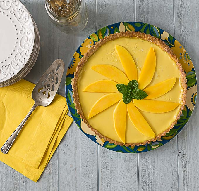 Get your bake on! You will love the Tropical flavors in this mango passion fruit tart! Sweet, creamy and tangy are all the wonderful flavors that will delight you! Baked in a nice sweet crunchy shortcrust. | ethnicspoon.com